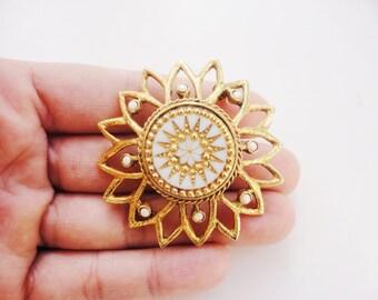 Statement sunburst - big flower brooch white and gold ornate glass center