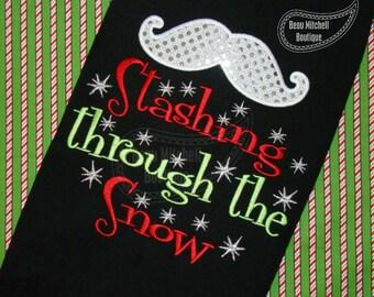Stashing through the snow with applique mustache