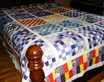 Multi-colored queen size scrappy quilt