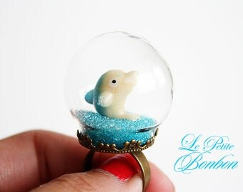 Dolphin in a glass globe ring