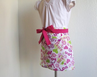 Childrens Half Apron - SALE  Love, Peace and Pink and Green Hearts...a sweet kids apron...has a slight glittery sparkle to it