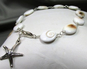 Spirits Eye Sea Shell with Star Fish in Sterling Silver