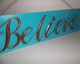 Believe/Metal Wall Sign/WallHanging/Sign/Vintage/Repurposed Wood Painted Teal/This is a vintage sign has a few dings in it.