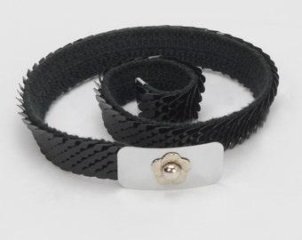 Black Stretch Serpentine Belt with Silvertone Buckle and Flower