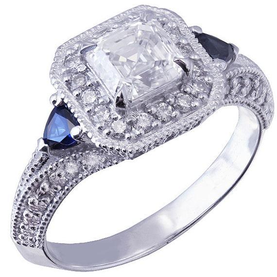 18k white gold asscher cut diamond and triangle sapphire