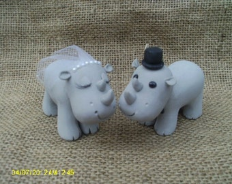 Hippo bride and groom wedding cake topper
