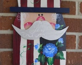 Wooden Patriotic Uncle Sam with Blue Roses