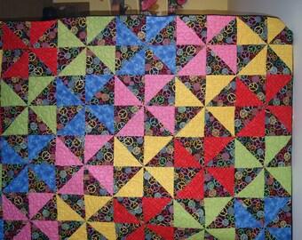 Rainbow pin wheel twin quilt