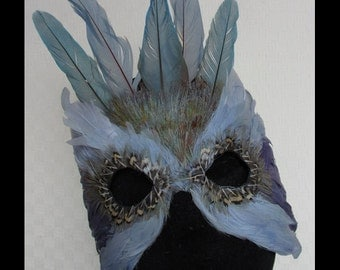 Light Blue and Purple Mardis Gras Feather Mask Crowned by Macaw Feathers