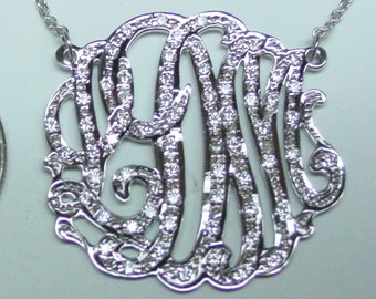 """sterling silver monogram  , 1.25""""  size ,  with  70 cz pave' set.. with a chain"""