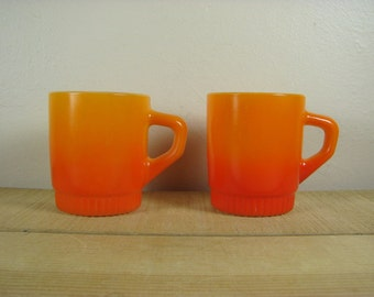 2 Fire King Anchor Hocking Flame Orange milk glass mugs