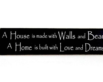 A House is Made with Walls and Beams wood sign