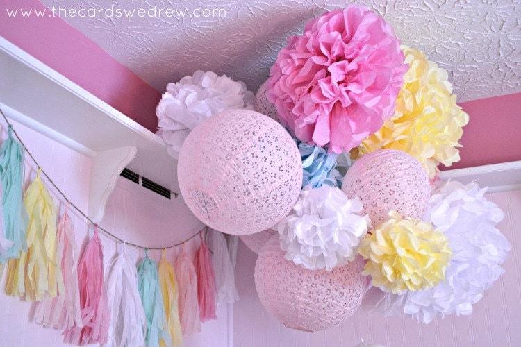 Nursery pom poms 7 tissue paper pom poms for nursery party for Pom pom room decor
