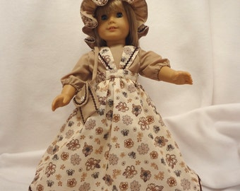 Five-piece outfit for 18 inch dolls.  Blouse, Jumper, Pantaloons, Cap and Purse.
