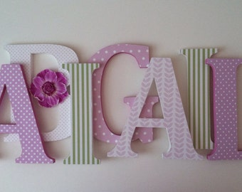 Wooden  letters for nursery in soft lilac, white, and green