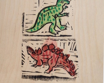 Linocut on wood panel--Double Dinosaurs 2, electric boogaloo (stegosaurus version)