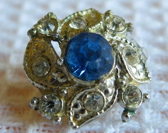 2 Lovely Vintage Buttons. EACH DIFFERENT, clear rhinestones with blue saphire coloured central stone.  LB12.5-10.26.4
