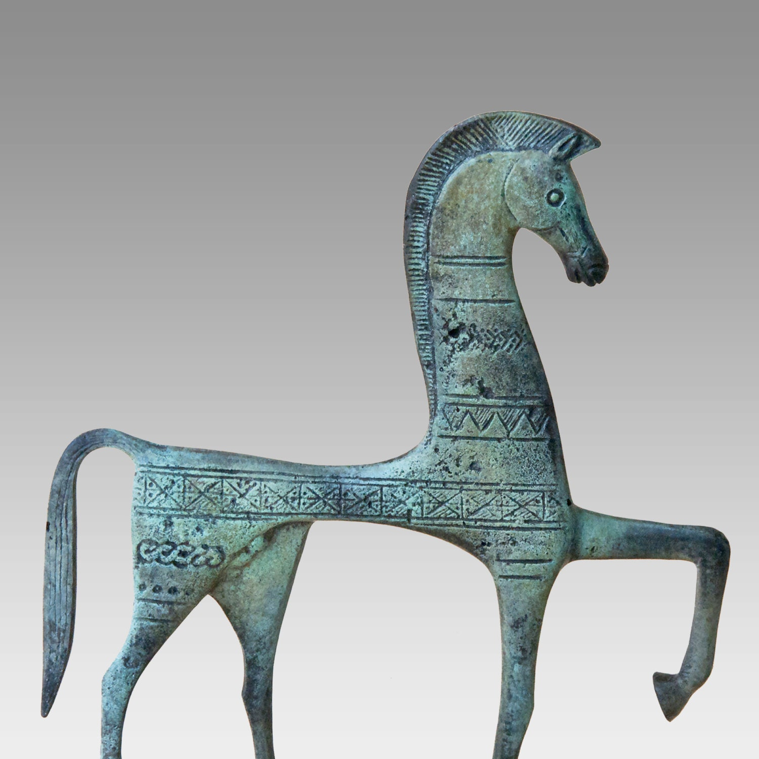 Large greek bronze horse decorated in the geometric style