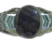Macrame Adjustable Bracelet with a Natural Spiderweb Obsidian Stone