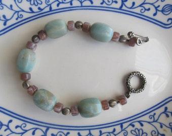 Bracelet with 1 1/2 cm x 1 cm light green stones