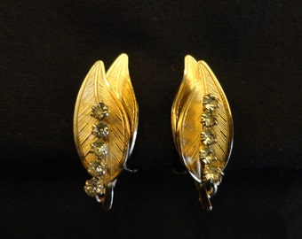 VINTAGE Earrings 1960s Gold Tone Clip - Two slender leaves one on top of other, center front leaf has line of 5 clear rhinestones - no mark