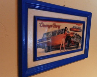 Retro Man Cave Art. Hand Fiberglass - Poly Resin Coated Framed Picture.  21x13 In. Blue Wood Frame, Orange Bang Lowrider Mag Chevy Pin Up.