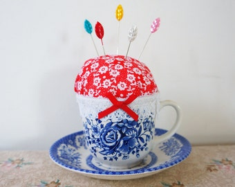 Floral fabric teacup pincushion with dressmakers novelty pins