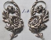 Left and right dogwood brass pendants, brass ox