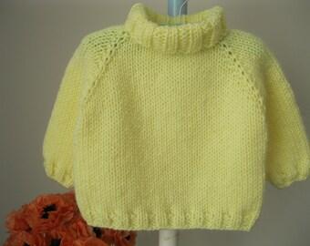 Handknit baby sweater.........light yellow turtleneck