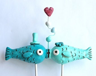 Aqua and Teal Kissing Fish wedding cake topper for your beach wedding as seen in Real Maine Weddings magazine