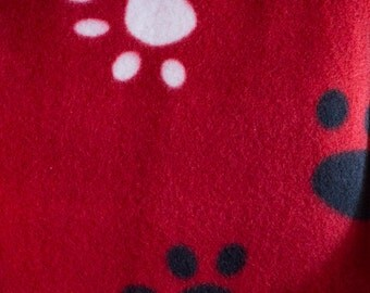 Red with Black and White Paw Print Fleece Fabric by the Yard