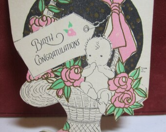 Darling unused 1920's art deco die cut gold gilded birth congratulations card newborn baby inside a large basket with pink flowers bow