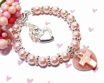 Pretty Pink Pearl Bracelet with Pink Shell Cross and Leaf Charms
