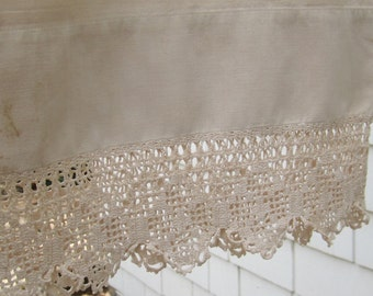 Tea stained pillowcase with crocheted lace edging