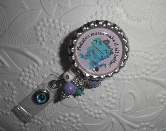 "Pediatric Nurse Bottle Cap - Professional Retractable ID Badge Reel With "" Pediatric Nurses Make It All Better"" on a Bottle Cap With Beads"