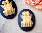 SPECIAL OFFER --- 40 x 30 mm Yellow Angels on Black Resin Cameo Cabochon (.ig)