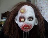 Zombie head trophy.