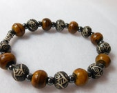 Mens Carved  Black Bone and Brown Horn Beads with hematite spacers, this bracelet is on a convenient stretchy string, pick your size