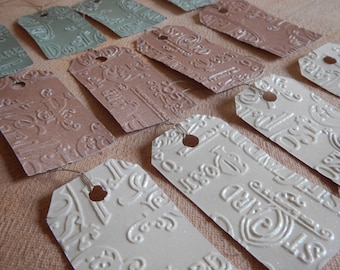 Gift tags with strings dozen 12 with glitters postal embossed