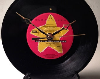 "Recycled DURAN DURAN 7"" Record / Meet El Presidente / Record clock"