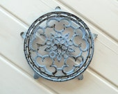 French vintage cast metal trivet in pale blue....shabby chic.