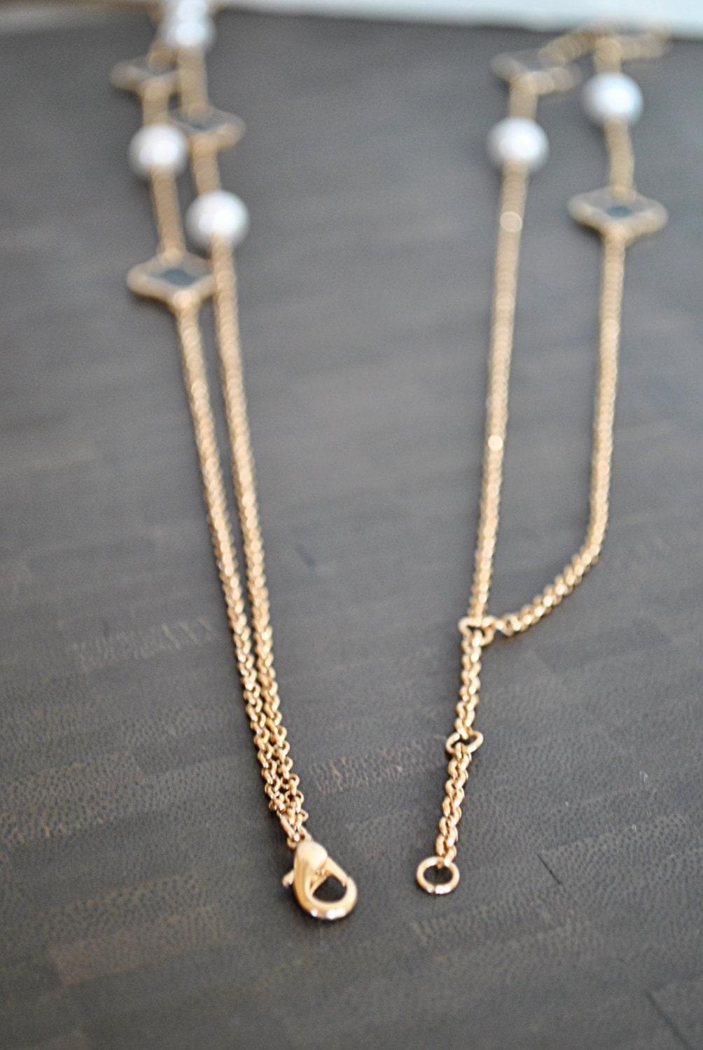 gold black and white clover necklace