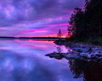 Dramatic purple sunset in Finland over a lake, surreal photo print to frame for your wall, violet sky, vertical format, nature landscape