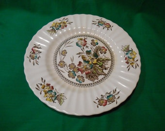 "One (1), 10"" Dinner Plate, from Wades, of England, in the Meadow Pattern."