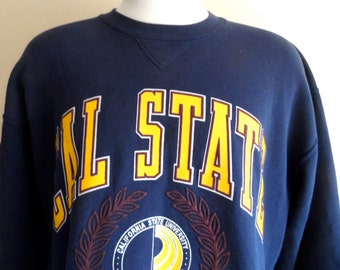 go CSUDH toros vintage 90's California State University Dominguez Hills navy blue fleece yellow maroon puffy print crest graphic sweatshirt