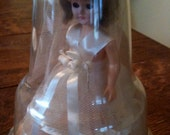 Bride Doll in Plastic Dome A & H in Cream Tulle Dress and Veil with Floral and Ribbon Accents