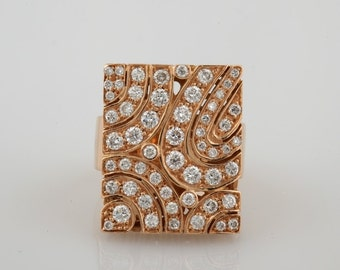 Striking artwork diamond panel ring from our actual collection