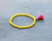 Yellow bracelet with hot pink tassel / charm bracelet for women