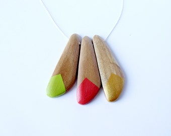 Geometric wooden necklace in avocado peach and gold.