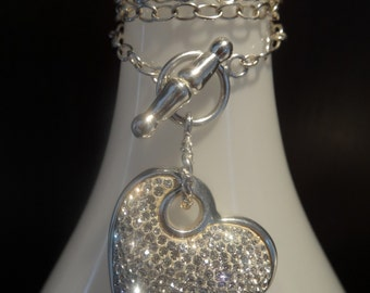 Sparkling sterling silver heart necklace.